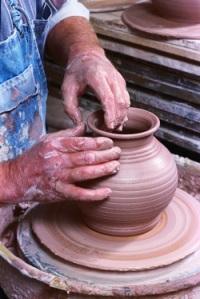 Potter Crafting Pot on Potter's Wheel